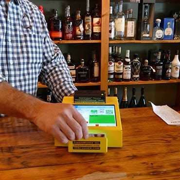 ID scanner on liquor store countertop
